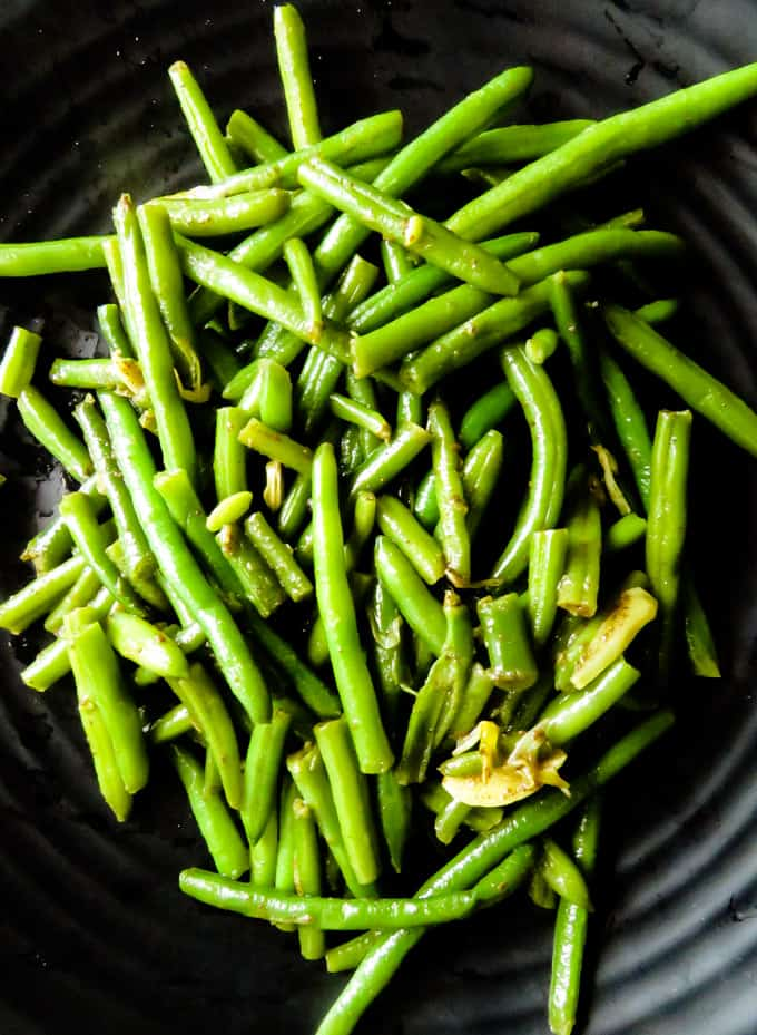 green beans-garlic stir-fried in browned butter.